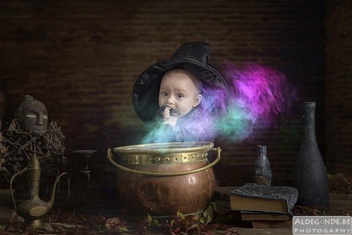 little halloween baby with cauldron